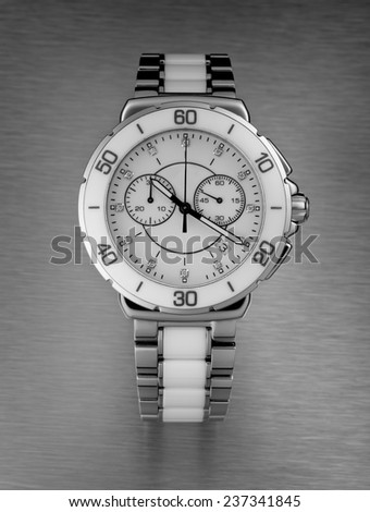 Luxury female wristwatch over the brushed metal background, front studio closeup - stock photo