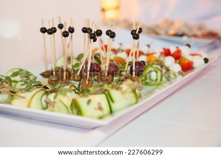 Luxury food on wedding table - canap - stock photo