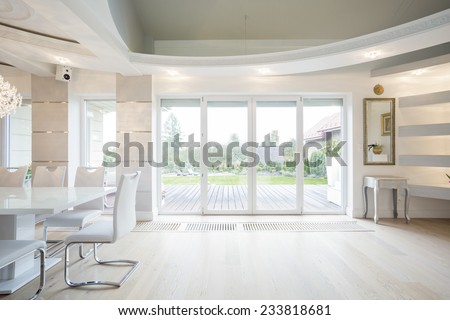 Luxury front room with window overlooking the garden - stock photo