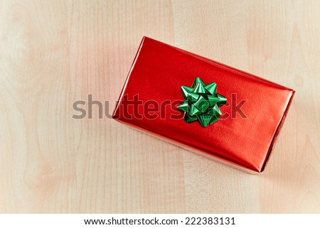 Luxury gift box with bow on wooden table, top view - stock photo