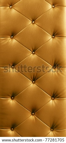 luxury gold button leather background - stock photo