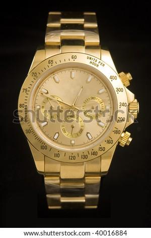 Luxury gold watch isolated on black background - stock photo