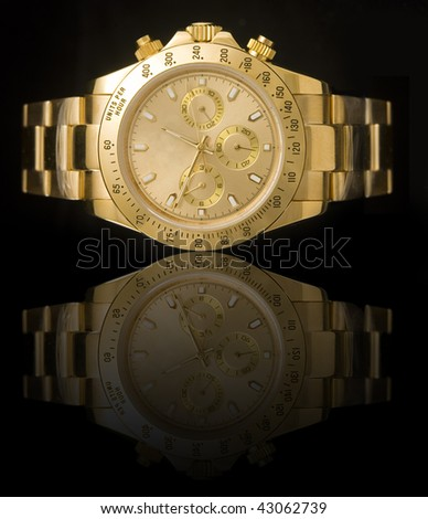 Luxury gold watch isolated on black background with reflection - stock photo