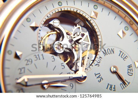 luxury gold watch swiss made - stock photo