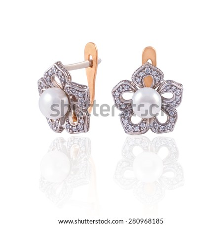 Luxury golden earrings beautiful flowers with diamonds and pearl isolated on white - stock photo