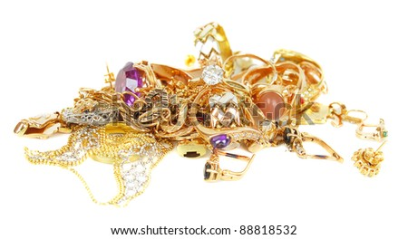 Luxury golden jewelry accessories isolated on the white with mirror reflection.