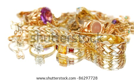 Luxury golden jewelry accessories isolated on the white with mirror reflection. Focus on the front rings.
