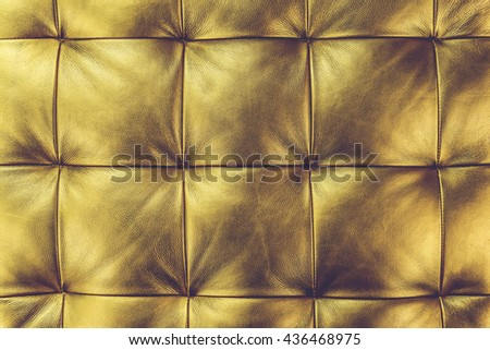 Luxury golden leather close-up background (Vintage filter effect used) - stock photo