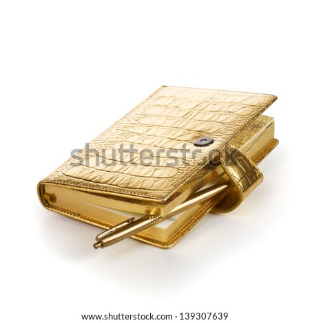 Luxury golden leather notebook with pen on white background - stock photo