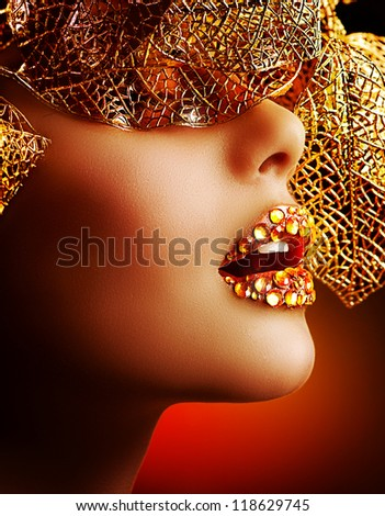 Luxury Golden Makeup. Beautiful Professional Holiday Make-up. Sexy Gold Lips.Fashion Art Portrait.Jewelry. Lips with Rhinestones - stock photo
