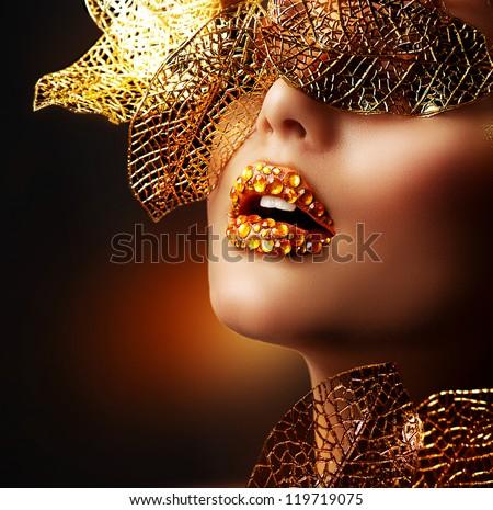Luxury Golden Makeup. Beautiful Professional Holiday Make-up. Sexy Gold Lips.Fashion Art Portrait.Jewelry. Jewellery. Jewelery - stock photo