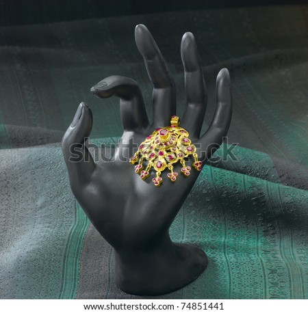Luxury golden pendant  with Siam Ruby, the famous gemstone from Thailand - stock photo