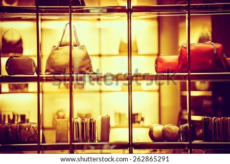 Luxury Goods Shopping. Luxury Purse Products For Woman. Store Front Closeup. - stock photo