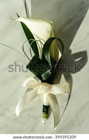luxury gorgeous wedding boutonniere with white calla and lily for groom - stock photo