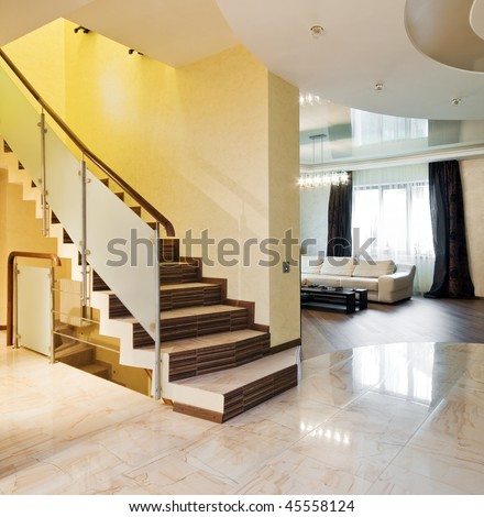 Luxury hall with staircase in a new house - stock photo