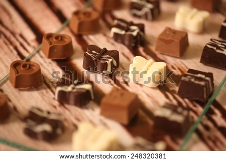 Luxury handmade chocolate bonbon assortment of delicious decorative round chocolates - stock photo