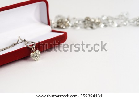 luxury heart necklace with stylish diamonds on white  background, present and love concept, valentine's day - stock photo