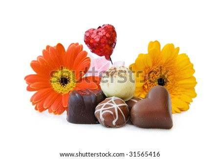 Luxury heart shaped chocolates with flowers for a special day.