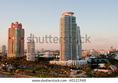 Luxury high rise condo buildings in a tropical location in morning light - stock photo