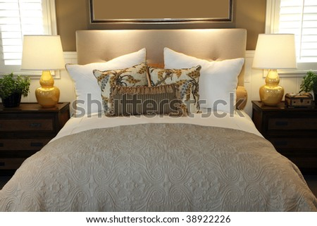 Luxury home bedroom with stylish pillows and decor. - stock photo
