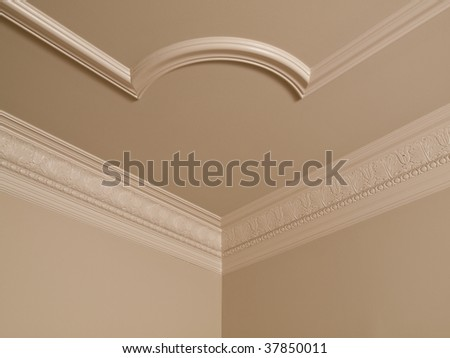 Luxury Home ceiling corner ornamental moulding detail - stock photo