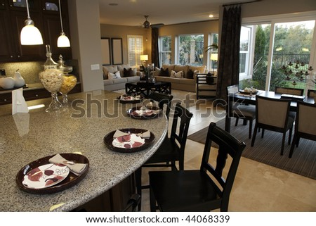 Luxury home designer kitchen with a granite island. - stock photo