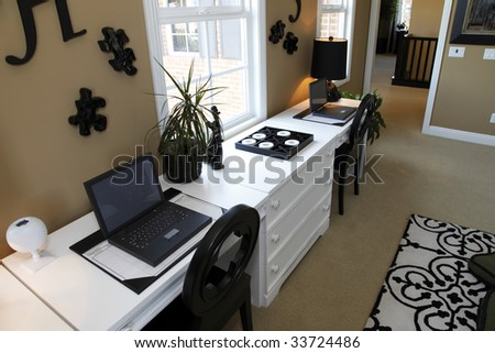 Luxury home desk with two computers. - stock photo
