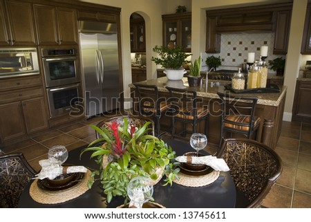 Luxury home dining room and kitchen. - stock photo