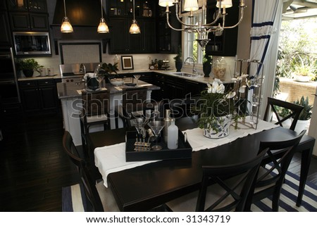 Luxury home dining room and modern kitchen. - stock photo