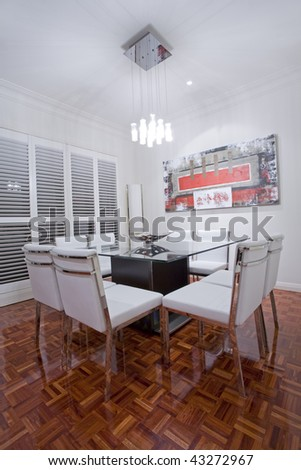 Luxury home dining room interior with dark brown wooden flooring and white leather dining furniture