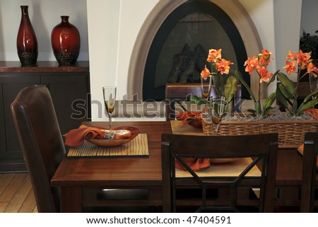 Luxury home dining table with exquisite tableware and decor. - stock photo