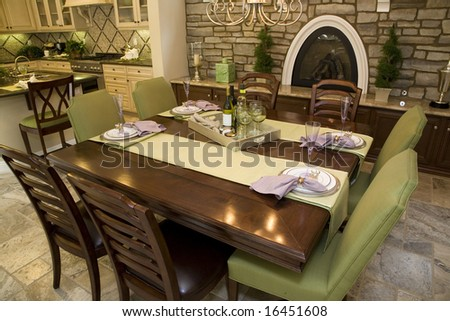 Luxury home dining table with modern tableware. - stock photo