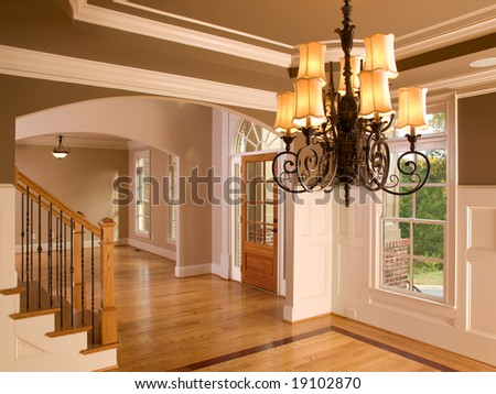 Luxury Home Entrance way with Ornate Hanging Light - stock photo