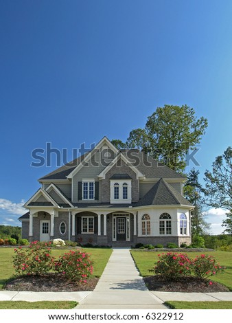 Luxury Home Exterior against blue sky