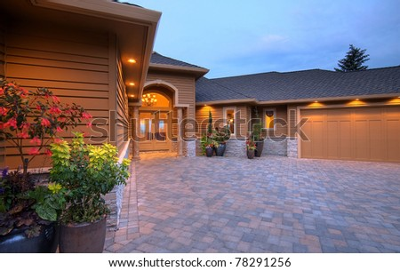 Luxury Home Exterior at Sunset - stock photo