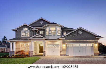 Luxury Home Exterior at Twilight - stock photo