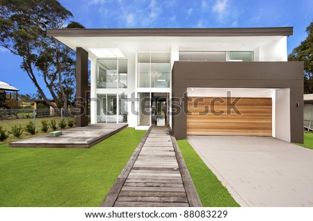luxury home frontage against blue sky - stock photo