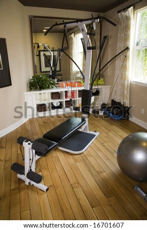 Luxury home gym with modern exercise equipment.