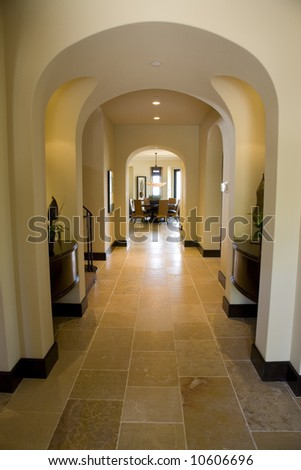 Luxury home hallway with a tiled floor. - stock photo