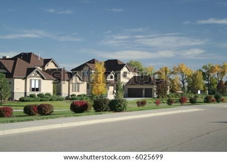 Luxury home in affluent neighborhood - stock photo
