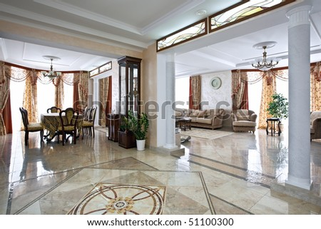Luxury home interior with lobby, living room and table for dinner in daylight - stock photo