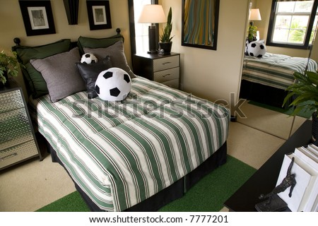 Luxury home kids bedroom with soccer decor theme. - stock photo