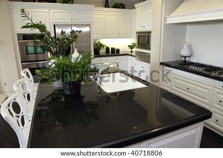 Luxury home kitchen large granite island. - stock photo