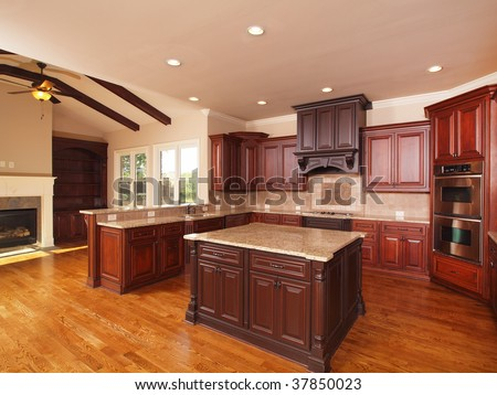 Luxury Home Kitchen side with center island and cabinets - stock photo