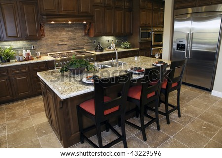 Luxury home kitchen with a granite breakfast counter. - stock photo