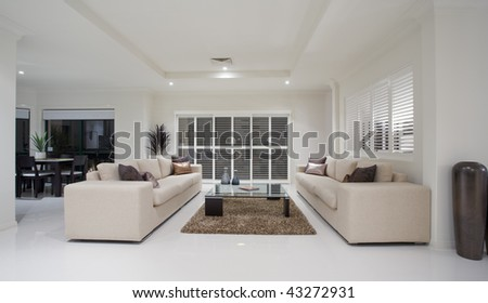Luxury home living room interior overlooking dining room