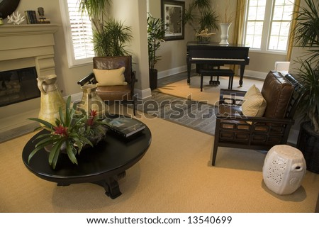 Luxury home living room with a fireplace and a grand piano. - stock photo