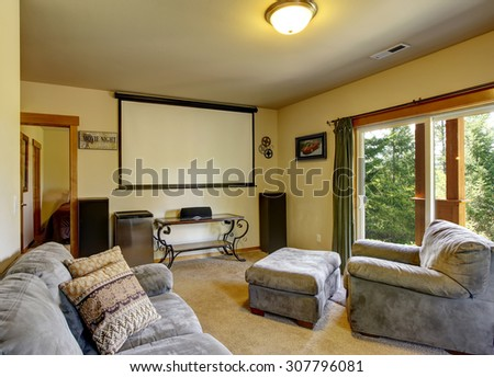 Luxury home theater in cabin style home with carpet. - stock photo