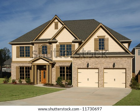 Luxury Home with driveway and blue sky - stock photo