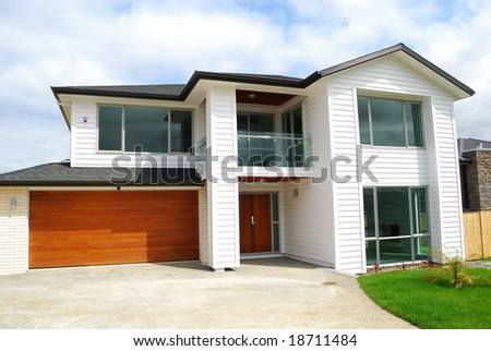 luxury home with landscaped front yard - stock photo